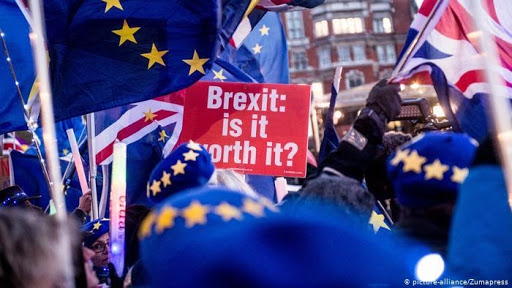 brexit is it worth it sign and UK flags